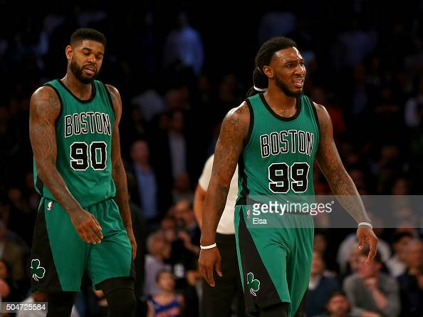 Amir Johnson and Jae Crowder of the Boston Celtics react to the loss to the New York Knicks at Madison Square Garden on January 12 2016 in New York...