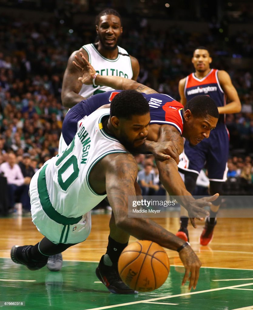 Amir Johnson #90 of the Boston Celtics and Bradley Beal #3 of the Washington Wizards battle for a loose ball during the first quarter of Game Two of the Eastern Conference Semifinals at TD Garden on May 2, 2017 in Boston, Massachusetts.