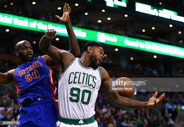 Amir Johnson of the Boston Celtics and Joel Anthony of the Detroit Pistons battle for a rebound during the second quarter at TD Garden on January 6...