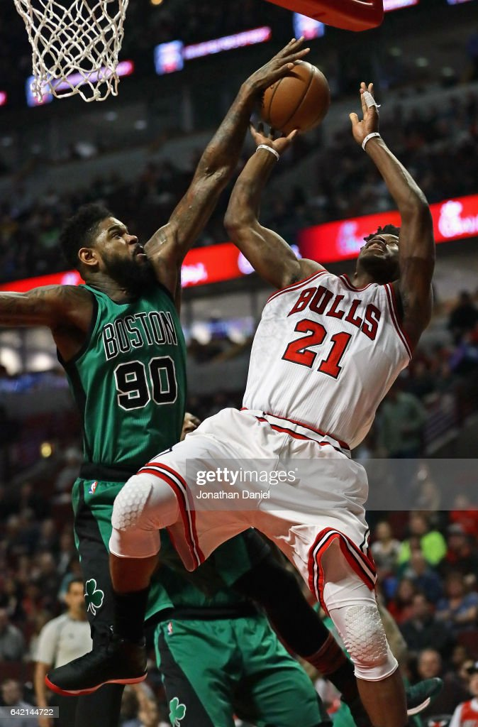 Amir Johnson #90 of the Boston Celtics blocks a shot attempt by Jimmy Butler #21 of the Chicago Bulls at the United Center on February 16, 2017 in Chicago, Illinois.