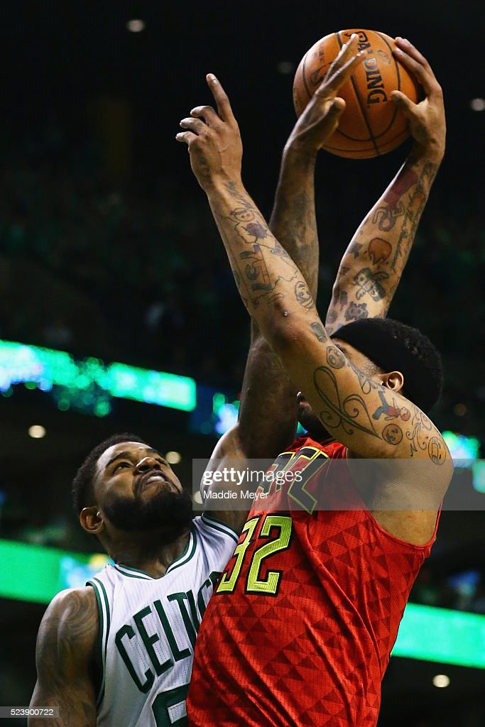Amir Johnson of the Boston Celtics blocks a shot by Mike Scott of the Atlanta Hawks during the third quarter of Game Four of the Eastern Conference...
