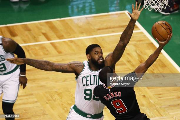 Amir Johnson of the Boston Celtics defends a shot by Rajon Rondo of the Chicago Bulls during the first quarter of Game Two of the Eastern Conference...