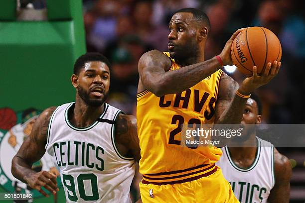 Amir Johnson of the Boston Celtics defends LeBron James of the Cleveland Cavaliers during the third quarter at TD Garden on December 15 2015 in...