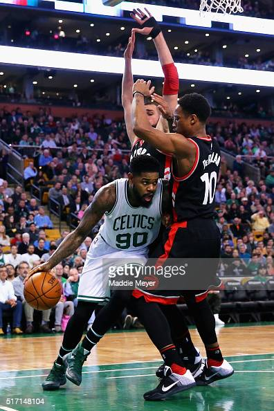 Amir Johnson of the Boston Celtics drives against DeMar DeRozan of the Toronto Raptors during the third quarter at TD Garden on March 23 2016 in...
