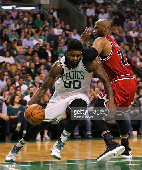 Amir Johnson of the Boston Celtics drives against Taj Gibson of the Chicago Bulls during the third quarter at TD Garden on November 2 2016 in Boston...