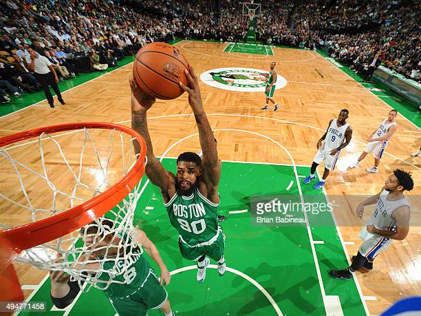 Amir Johnson of the Boston Celtics drives to the basket against the Philadelphia 76ers on October 28 2015 at the TD Garden in Boston Masachusetts...