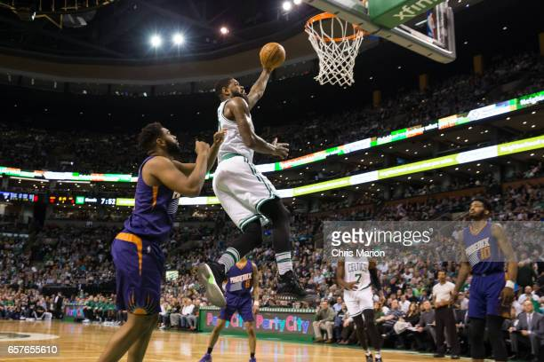 Amir Johnson of the Boston Celtics drives to the basket against the Phoenix Suns on March 24 2017 at TD Garden in Boston Massachusetts NOTE TO USER...