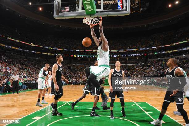 Amir Johnson of the Boston Celtics dunks against the Brooklyn Nets on April 10 2017 at the TD Garden in Boston Massachusetts NOTE TO USER User...