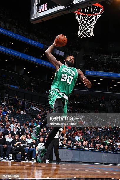 Amir Johnson of the Boston Celtics dunks against the Brooklyn Nets during the preseason game on October 14 2015 at Barclays Center in Brooklyn New...