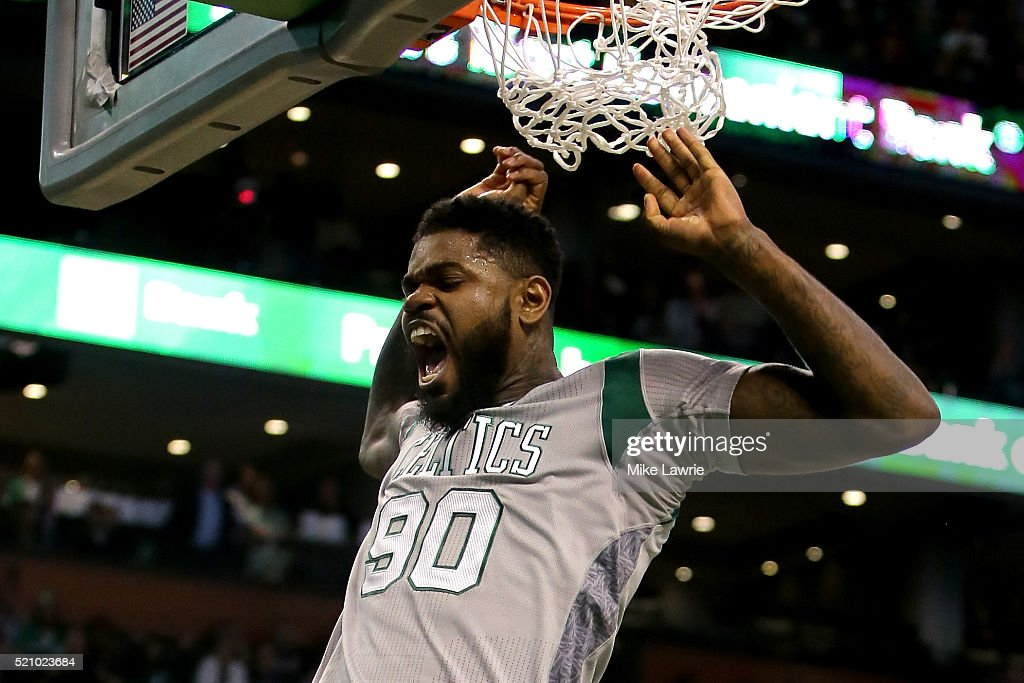 Amir Johnson of the Boston Celtics dunks in the third quarter against the Miami Heat at TD Garden on April 13 2016 in Boston Massachusetts NOTE TO...