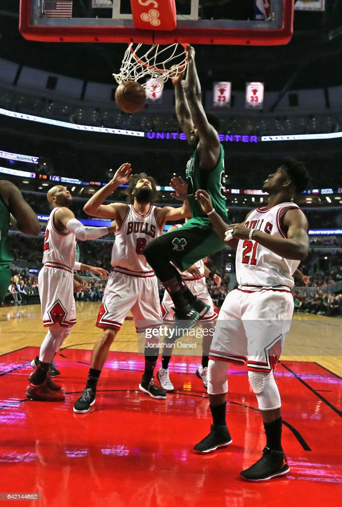 Amir Johnson #90 of the Boston Celtics dunks over (L-R) Taj Gibson #22, Robin Lopez #8 and Jimmy Butler #21 of the Chicago Bulls at the United Center on February 16, 2017 in Chicago, Illinois.