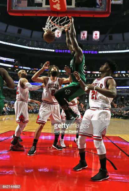 Amir Johnson of the Boston Celtics dunks over Taj Gibson Robin Lopez and Jimmy Butler of the Chicago Bulls at the United Center on February 16 2017...
