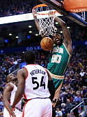 Amir Johnson of the Boston Celtics dunks the ball during the second half of an NBA game against the Toronto Raptors at the Air Canada Centre on March...