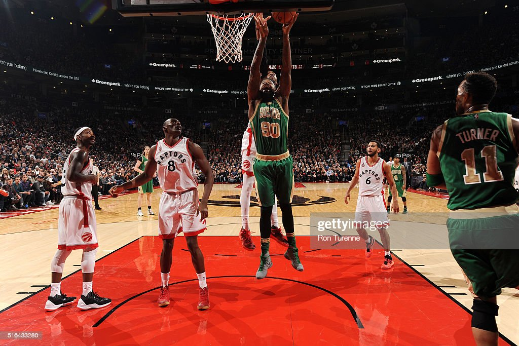 Amir Johnson #90 of the Boston Celtics goes for the layup during the game against the Toronto Raptors on March 18, 2016 at the Air Canada Centre in Toronto, Ontario, Canada.
