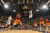 Amir Johnson of the Boston Celtics goes to the basket against the Indiana Pacers on March 15 2016 at Bankers Life Fieldhouse in Indianapolis Indiana...