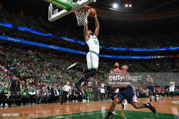 Amir Johnson of the Boston Celtics goes up for a dunk against the Washington Wizards during Game Five of the Eastern Conference Semifinals of the...