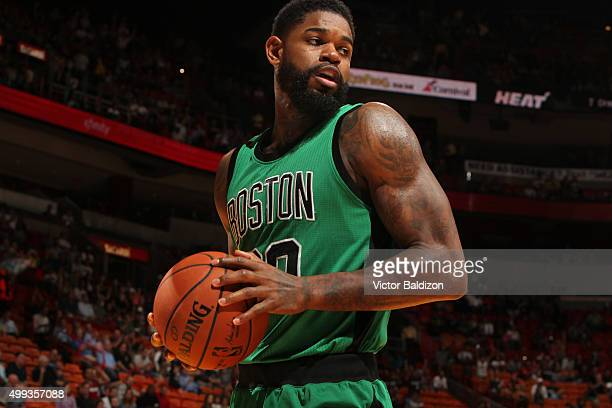 Amir Johnson of the Boston Celtics handles the ball against the Denver Nuggets on November 30 2015 at American Airlines Arena in Miami Florida NOTE...