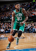 Amir Johnson of the Boston Celtics handles the ball against the Dallas Mavericks on January 18 2016 at the American Airlines Center in Dallas Texas...