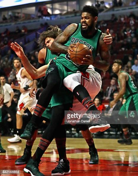 Amir Johnson of the Boston Celtics is fouled by Robin Lopez of the Chicago Bulls as he rebounds at the United Center on February 16 2017 in Chicago...