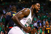 Amir Johnson of the Boston Celtics reacts after scoring against the Atlanta Hawks during the first quarter of Game Three of the Eastern Conference...
