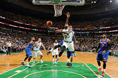 Amir Johnson of the Boston Celtics shoots the ball against the New York Knicks during a preseason game on October 22 2015 at the TD Garden in Boston...