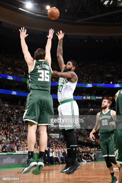 Amir Johnson of the Boston Celtics shoots the ball during the game against the Milwaukee Bucks on March 29 2017 at TD Garden in Boston Massachusetts...