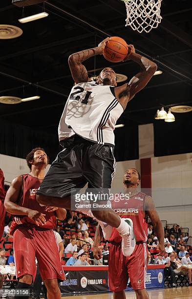 Amir Johnson of the Milwaukee Bucks takes the ball to the basket against the Cleveland Cavaliers during the NBA Summer League presented by EA Sports...