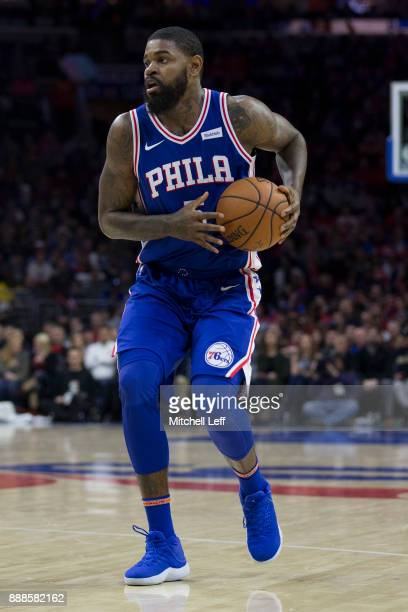 Amir Johnson of the Philadelphia 76ers controls the ball against the Phoenix Suns at the Wells Fargo Center on December 4 2017 in Philadelphia...
