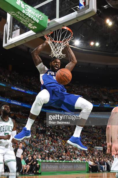 Amir Johnson of the Philadelphia 76ers dunks the ball during the preseason game against the Boston Celtics on October 9 2017 at the TD Garden in...
