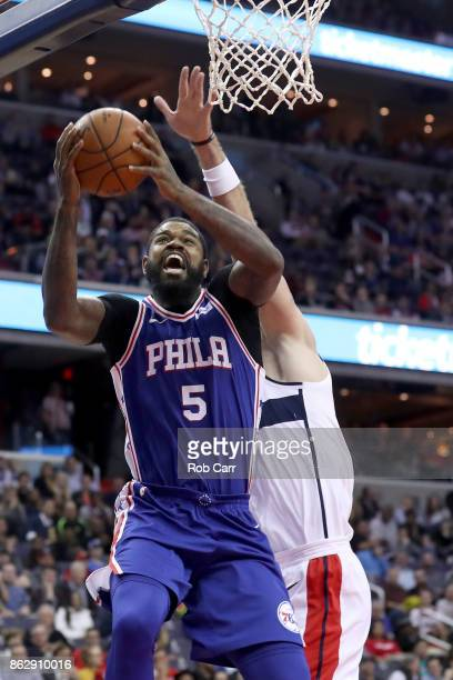 Amir Johnson of the Philadelphia 76ers puts up a shot in front of Marcin Gortat of the Washington Wizards in the first half at Capital One Arena on...