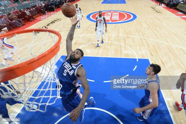 Amir Johnson of the Philadelphia 76ers rebounds against the Detroit Pistons on October 23 2017 at Little Caesars Arena in Detroit Michigan NOTE TO...