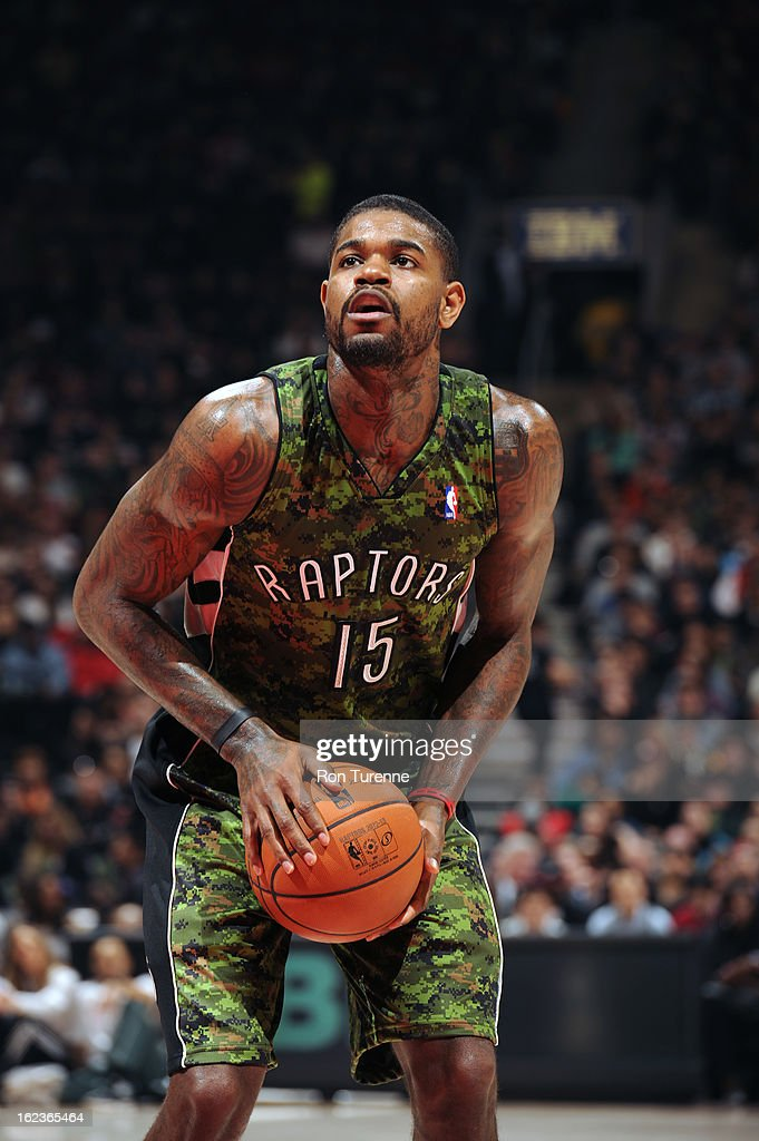 Amir Johnson #15 of the Toronto Raptors attempts a foul shot against the Cleveland Cavaliers on January 26, 2013 at the Air Canada Centre in Toronto, Ontario, Canada.