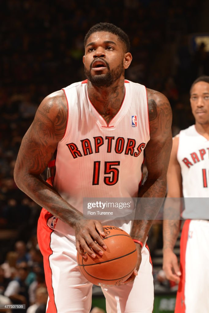 <a gi-track='captionPersonalityLinkClicked' href=/galleries/search?phrase=Amir+Johnson&family=editorial&specificpeople=556786 ng-click='$event.stopPropagation()'>Amir Johnson</a> #15 of the Toronto Raptors attempts a free throw against the Sacramento Kings on March 7, 2014 at the Air Canada Centre in Toronto, Ontario, Canada.