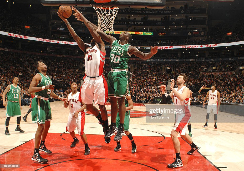 Amir Johnson #15 of the Toronto Raptors battle for the ball control with Brandon Bass #30 of the Boston Celtics during the game between the the Toronto Raptors and the Boston Celtics on February 6, 2013 at the Air Canada Centre in Toronto, Ontario, Canada.