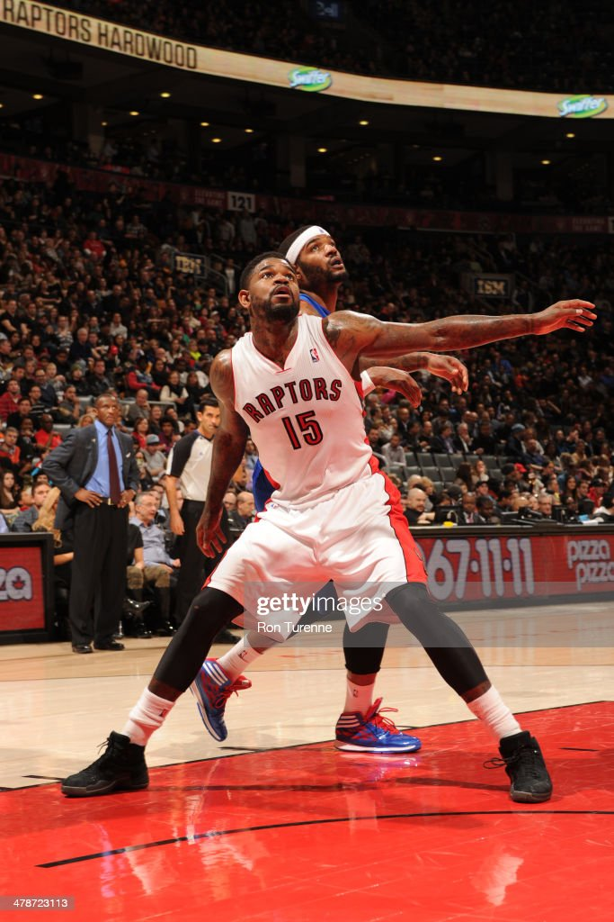 <a gi-track='captionPersonalityLinkClicked' href=/galleries/search?phrase=Amir+Johnson&family=editorial&specificpeople=556786 ng-click='$event.stopPropagation()'>Amir Johnson</a> #15 of the Toronto Raptors battles for position against <a gi-track='captionPersonalityLinkClicked' href=/galleries/search?phrase=Josh+Smith+-+Basketball+Player+-+Born+1985&family=editorial&specificpeople=201983 ng-click='$event.stopPropagation()'>Josh Smith</a> #6 of the Detroit Pistons on March 12, 2014 at the Air Canada Centre in Toronto, Ontario, Canada.