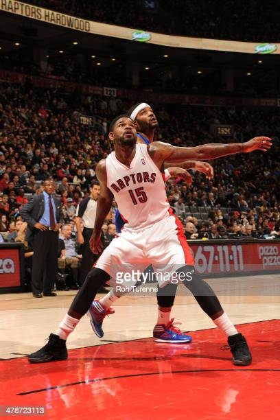 Amir Johnson of the Toronto Raptors battles for position against Josh Smith of the Detroit Pistons on March 12 2014 at the Air Canada Centre in...