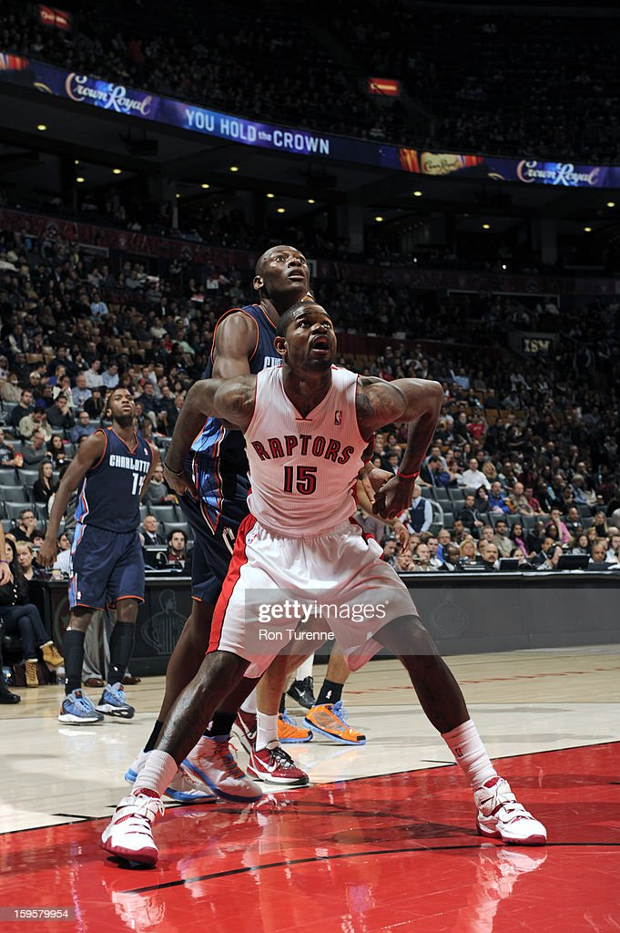 Amir Johnson #15 of the Toronto Raptors boxes out Bismack Biyombo #0 of the Charlotte Bobcats on January 11, 2013 at the Air Canada Centre in Toronto, Ontario, Canada.