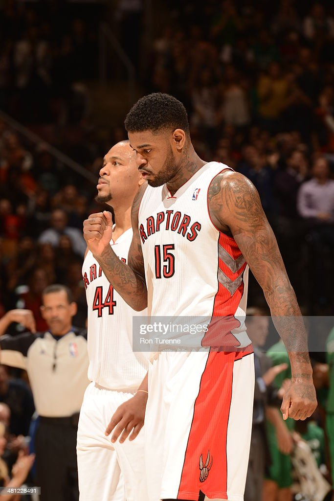 <a gi-track='captionPersonalityLinkClicked' href=/galleries/search?phrase=Amir+Johnson&family=editorial&specificpeople=556786 ng-click='$event.stopPropagation()'>Amir Johnson</a> #15 of the Toronto Raptors celebrates a game winning basket during the game against the Boston Celtics on March 28, 2014 at the Air Canada Centre in Toronto, Ontario, Canada.