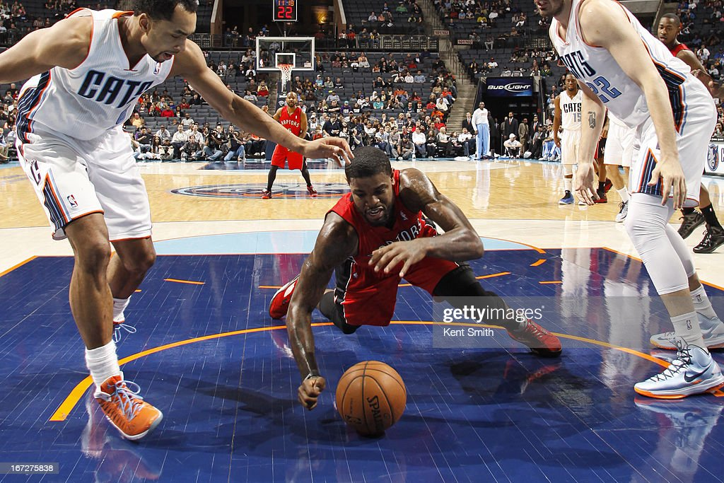 Amir Johnson #15 of the Toronto Raptors dives for a loose ball against the Charlotte Bobcats at the Time Warner Cable Arena on March 20, 2013 in Charlotte, North Carolina.