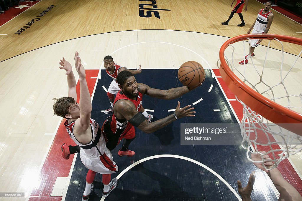 <a gi-track='captionPersonalityLinkClicked' href=/galleries/search?phrase=Amir+Johnson&family=editorial&specificpeople=556786 ng-click='$event.stopPropagation()'>Amir Johnson</a> #15 of the Toronto Raptors drives to the basket against the Washington Wizards at the Verizon Center on March 31, 2013 in Washington, DC.