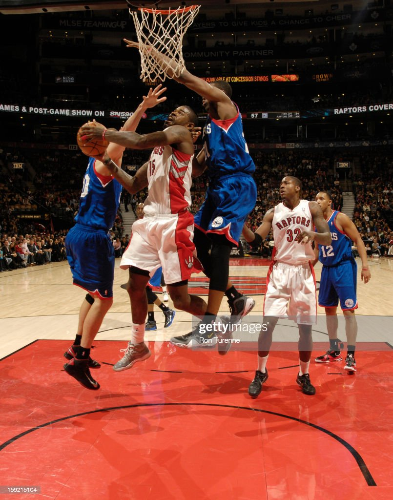 <a gi-track='captionPersonalityLinkClicked' href=/galleries/search?phrase=Amir+Johnson&family=editorial&specificpeople=556786 ng-click='$event.stopPropagation()'>Amir Johnson</a> #15 of the Toronto Raptors drives to the basket in traffic against the Philadelphia 76ers during the game on January 9, 2013 at the Air Canada Centre in Toronto, Ontario, Canada.