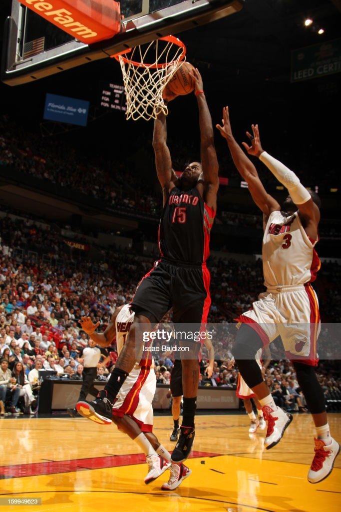 Amir Johnson #15 of the Toronto Raptors dunks against Dwyane Wade #3 of the Miami Heat on January 23, 2013 at American Airlines Arena in Miami, Florida.