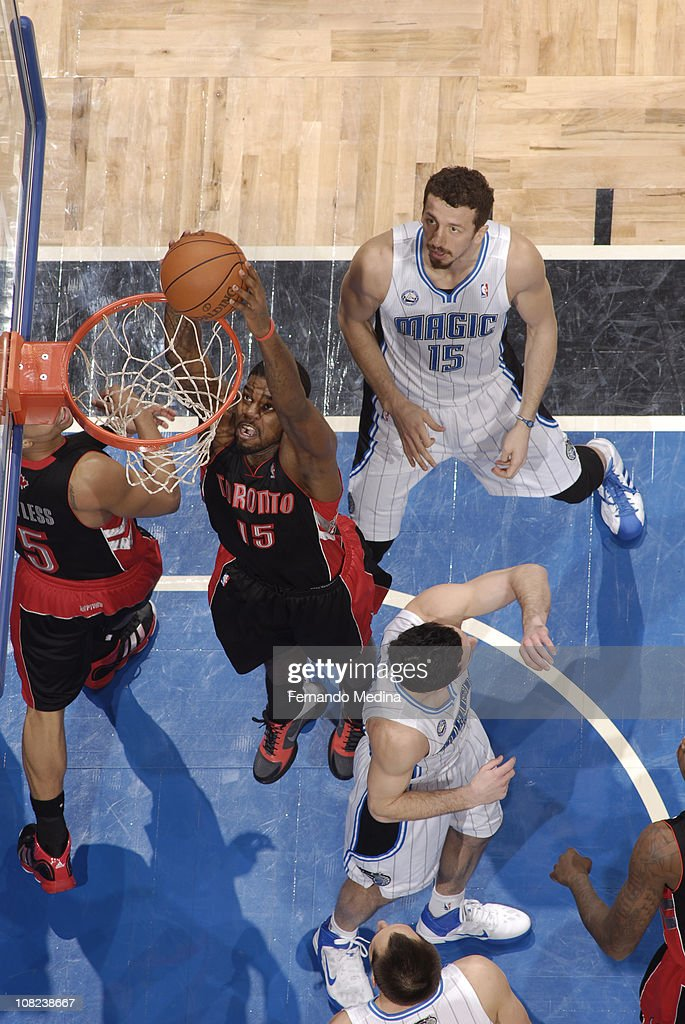 <a gi-track='captionPersonalityLinkClicked' href=/galleries/search?phrase=Amir+Johnson&family=editorial&specificpeople=556786 ng-click='$event.stopPropagation()'>Amir Johnson</a> #15 of the Toronto Raptors dunks against <a gi-track='captionPersonalityLinkClicked' href=/galleries/search?phrase=Hedo+Turkoglu&family=editorial&specificpeople=201639 ng-click='$event.stopPropagation()'>Hedo Turkoglu</a> #15 of the Orlando Magic on January 21, 2011 at the Amway Center in Orlando, Florida.
