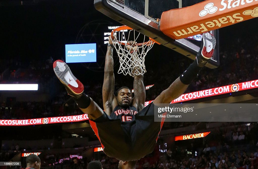 Amir Johnson #15 of the Toronto Raptors dunks during a game against the Miami Heat at American Airlines Arena on January 23, 2013 in Miami, Florida.