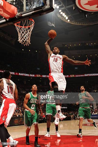 Amir Johnson of the Toronto Raptors dunks the ball against the Boston Celtics on October 23 2013 at the Air Canada Centre in Toronto Ontario Canada...