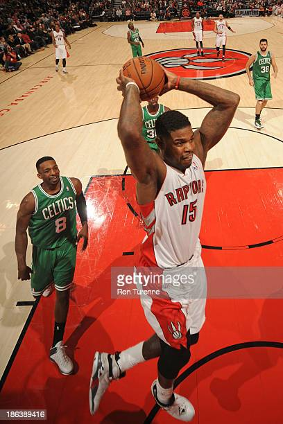 Amir Johnson of the Toronto Raptors dunks the ball against the Boston Celtics during the game on October 23 2013 at the Air Canada Centre in Toronto...