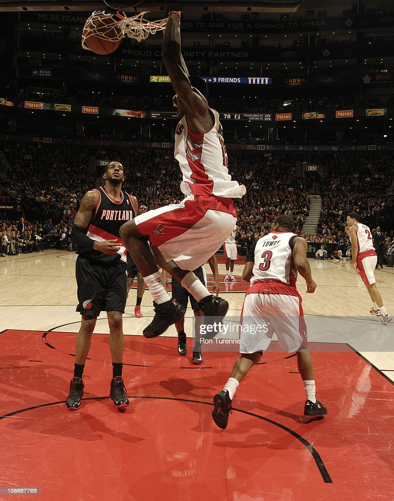 <a gi-track='captionPersonalityLinkClicked' href=/galleries/search?phrase=Amir+Johnson&family=editorial&specificpeople=556786 ng-click='$event.stopPropagation()'>Amir Johnson</a> #15 of the Toronto Raptors dunks the ball against the Portland Trail Blazers during the game on January 2, 2013 at the Air Canada Centre in Toronto, Ontario, Canada.