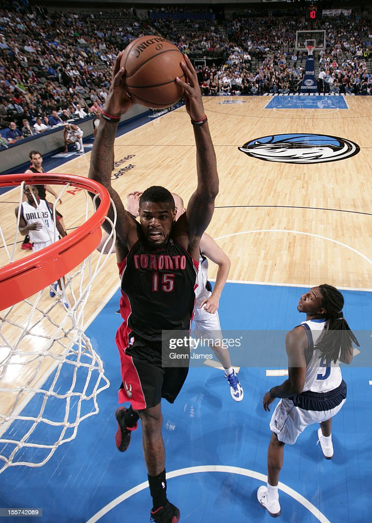 Amir Johnson #15 of the Toronto Raptors flies in for the dunk against Jae Crowder #9 of the Dallas Mavericks on November 7, 2012 at the American Airlines Center in Dallas, Texas.