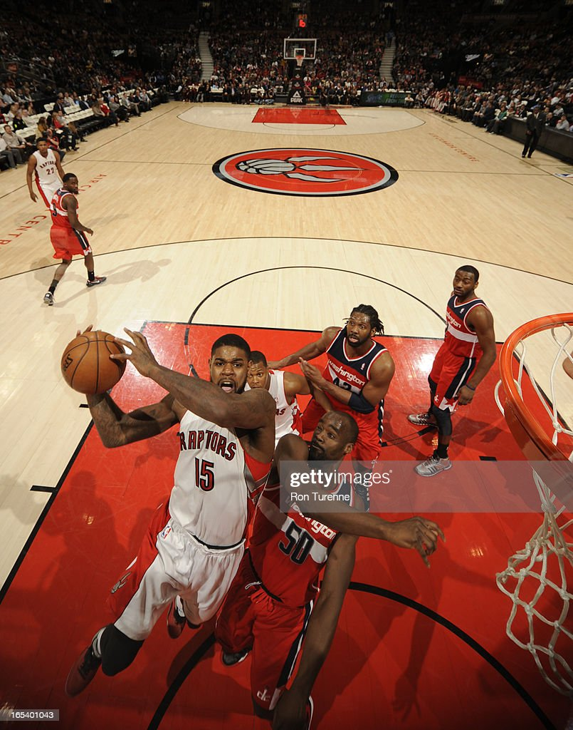Amir Johnson #15 of the Toronto Raptors glides to the basket against Emeka Okafor #50 of the Washington Wizards during the game on April 3, 2013 at the Air Canada Centre in Toronto, Ontario, Canada.