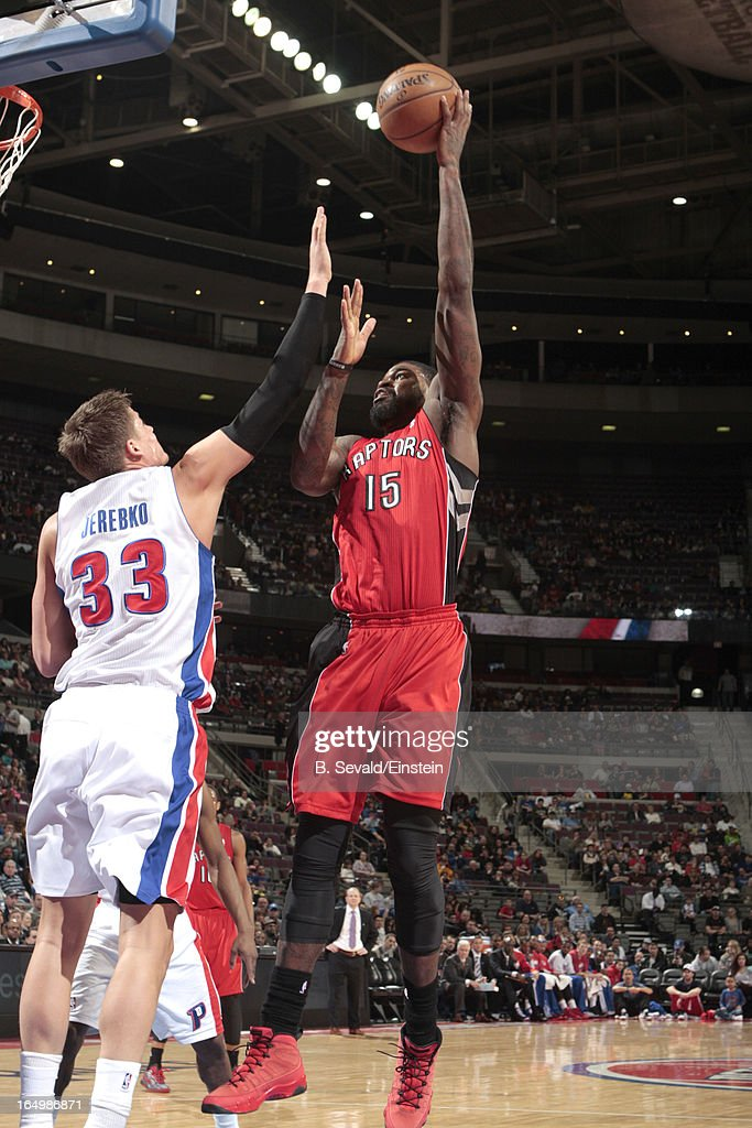 Amir Johnson #15 of the Toronto Raptors goes for a jump shot against Jonas Jerebko #33 of the Detroit Pistons during the game between the Detroit Pistons and the Toronto Raptors on March 29, 2013 at The Palace of Auburn Hills in Auburn Hills, Michigan.